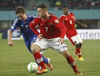Marko Arnautovic (R) of Austria and Hallur Hansson of Faroe Islands fight for the ball dur