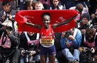 Mary Keitany of Kenya celebrates after winning the women's London Marathon April 22, 2012.