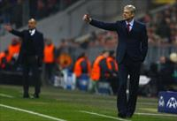 Arsenal's coach Arsene Wenger (R) reacts next to Bayern Munich's coach Pep Guardiola durin