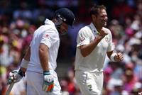 Australia's Ryan Harris (R) celebrates after taking the wicket of England's Ian Bell durin