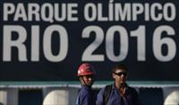 Construction workers on strike stand outside the Rio 2016 Olympic Park construction site i