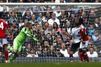 Tottenham Hotspur's Younes Kaboul (2nd R) scores a goal against Fulham during their Englis