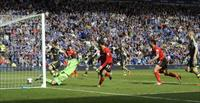 Cardiff City's Juan Cala (27) scores a goal that is disallowed during their English Premie