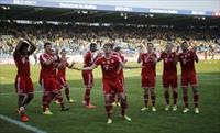 Bayern Munich players celebrate after their German first division Bundesliga soccer match
