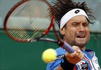 David Ferrer of Spain returns the ball to his compatriot Rafael Nadal during their quarter