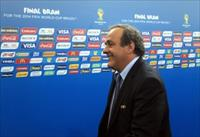 Former France soccer player and UEFA President Michel Platini arrives for the draw for the