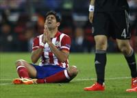 Atletico Madrid's Diego Costa reacts after missing a goal opportunity during their Champio