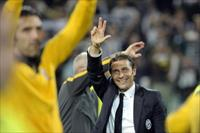 Juventus' Antonio Conte celebrates after winning the Serie A championship at the end of th