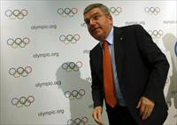 International Olympic Committee (IOC) President Thomas Bach leaves after a news conference