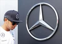 Mercedes Formula One driver Lewis Hamilton of Britain walks in at the Hungaroring circuit,