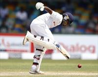 Sri Lanka's Mahela Jayawardene reacts after the ball hit his leg during the second day of