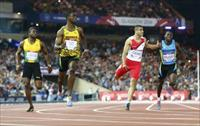 Kemar Bailey-Cole (2nd L) of Jamaica finishes first place ahead of Adam Gemili (2nd R) of