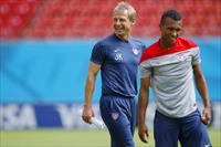 The U.S. national soccer team head coach Juergen Klinsmann (L) smiles as his team, includi