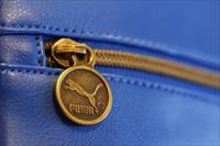 A handbag with the logo of German sports goods firm Puma is pictured in a shop after the c