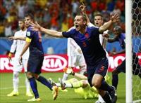 Stefan de Vrij of the Netherlands celebrates after scoring a goal against Spain during the