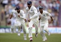India's Shikhar Dhawan, Ravindra Jadeja (L) and Ajinkya Rahane (R) chase a ball during the