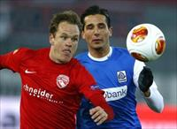 FC Thun's Lukas Schenkel (L) fights for the ball with Racing Genk's Youssef Makraou during