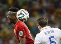 Belgium's Divock Origi jumps for the ball with Matt Besler of the U.S. during their 2014 W