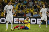 Ecuador's Cristian Noboa reacts after a missed opportunity at a goal beside France's Morga