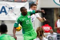 Jun 7, 2014; Jacksonville, FL, USA; Nigeria forward Shola Ameobi (23) and United States de