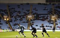 Coventry City play Portsmouth in front of a sparse crowd during their FA Cup soccer match