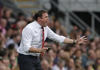Malky Mackay reacts during their English Premier League soccer match against Tottenham Hot
