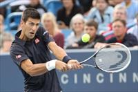 Novak Djokovic returns the serve of Gilles Simon on day two of the Western and Southern Op
