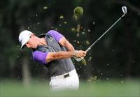 PGA golfer Rory McIlroy hits from the 12th fairway during the final round of the 2014 PGA