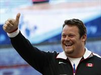 Bronze medallist Dylan Armstrong of Canada gestures at the men's shot put victory ceremony
