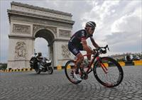 Iam team rider Sylvain Chavanel of France rides near the Arc de Triomphe at the end of the