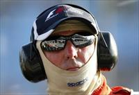 Marussia Formula One driver Max Chilton of Britain is reflected in the sunglasses of a rac