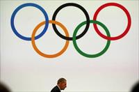 President of the International Olympic Committee (IOC) Jacques Rogge (L) attends the board