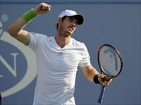 Andy Murray of Britain reacts after defeating Jo-Wilfried Tsonga of France during their ma