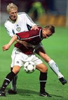 Andrey Gusin of Dynamo Kiev (rear) tries to stop Horst Sigl of Czech Sparta Prague during