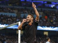 AS Roma's Francesco Totti celebrates scoring a goal against Manchester City during their C