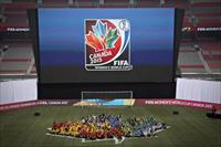 Young soccer players form the logo for the 2015 FIFA Women's World Cup during its unveilin