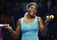 Serena Williams of the U.S. smiles to the crowd after defeating Eugenie Bouchard of Canada