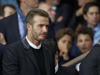 Former soccer player David Beckham arrive to attend the Champions League Group F soccer ma