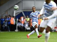 Queens Park Rangers' Rio Ferdinand plays the ball up the pitch during their English Premie