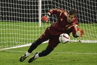 Iker Casillas saves a ball during a training session at Balaidos stadium in Vigo, November