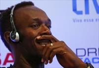 Jamaican Olympic gold medallist Usain Bolt smiles during a news conference to present the