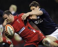 Wales' Jamie Roberts (L) scores a try against Scotland during their Six Nations Championsh