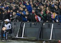 Feyenoord fans react as AS Roma players celebrate their goal against Feyenoord during thei