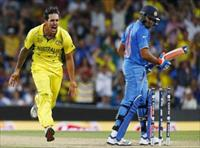 Australian bowler Mitchell Johnson (L) reacts after bowling out India's Rohit Sharma (R) d