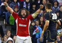 Wales' Adam Jones reacts after the referee awarded them a penalty in the final minute of t