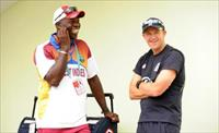 Ottis Gibson chats with Andy Flower (R) at Providence stadium during the ICC World Twenty2