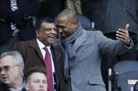 QPR Chairman Tony Fernandes (L) and QPR Director of Football Les Ferdinand in the stands.