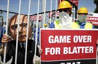 Activists from advocacy group Avaaz demonstrate near the Hallenstadion, where the 65th FIF
