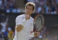 Andy Murray of Britain reacts during his match against Ivo Karlovic of Croatia at the Wimb