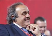UEFA President Michel Platini  smiles before the preliminary draw for the 2018 FIFA World